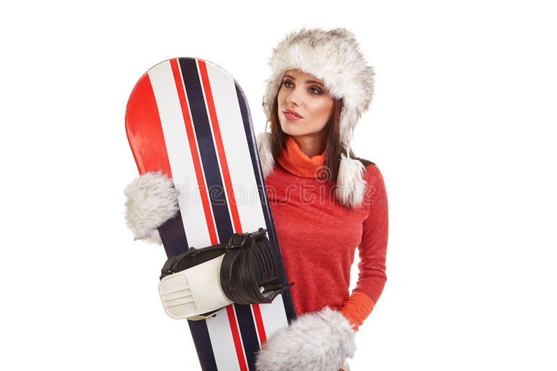 Model wearing winter suit holding a snowboard. Model wearing snowboard suit holding a snowboard in studio royalty free stock photography