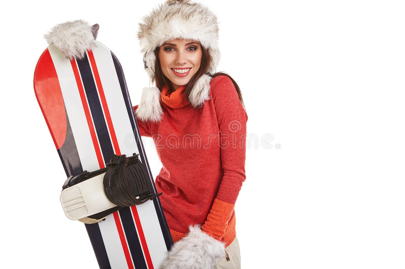 Model wearing winter suit holding a snowboard. Model wearing snowboard suit holding a snowboard in studio royalty free stock image
