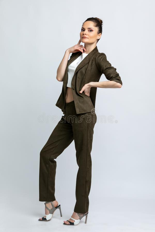 Model in white blouse, swamp jacket and trousers isolated on white background. stock photos