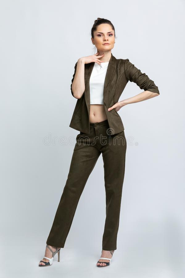 Model in white blouse, swamp jacket and trousers isolated on white background. royalty free stock photos