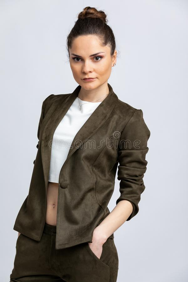 Model in white blouse, swamp jacket and trousers isolated on white background. stock image