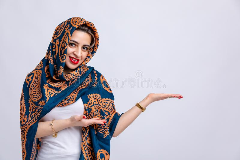 Model in white t-shirt, with blue kelagayi scarf on head with Golden patterns isolated on white background. royalty free stock image