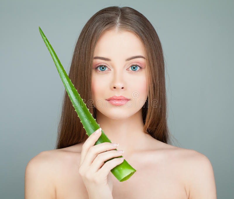 Model Woman with Cute Face, Fresh Skin and Green Aloe Leaf stock photography