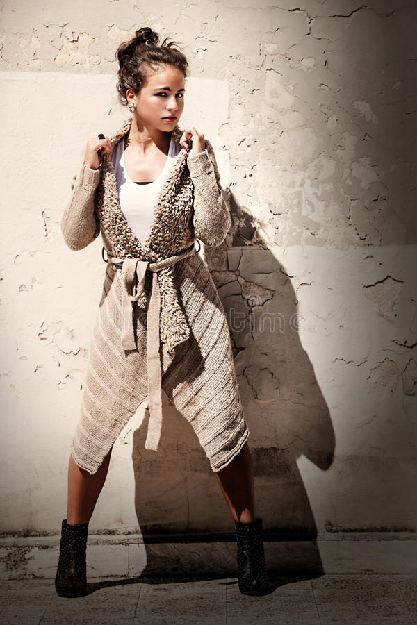 Model woman grunge background. Leg outstretched. Wool sweater. royalty free stock photo