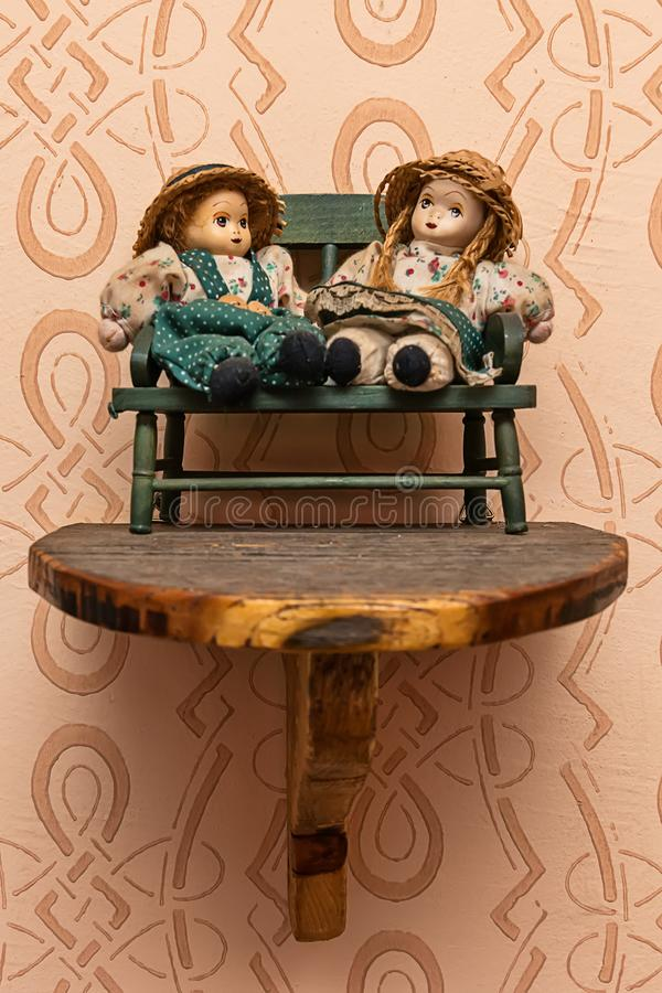 A model of wooden dolls on the wall.  stock photos