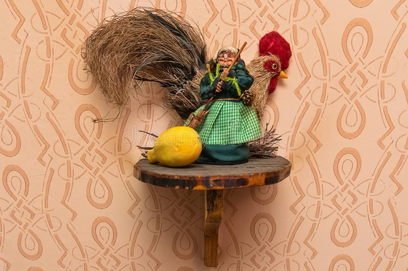A model of wooden dolls on the wall.  stock images