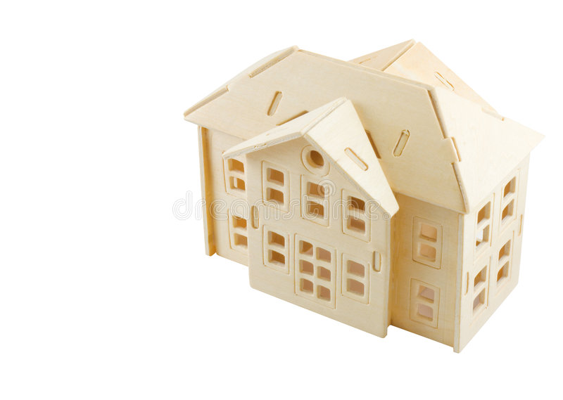 Model of wooden house. High angle view of model of wooden house isolated on white background with clipping path and copy space stock photos