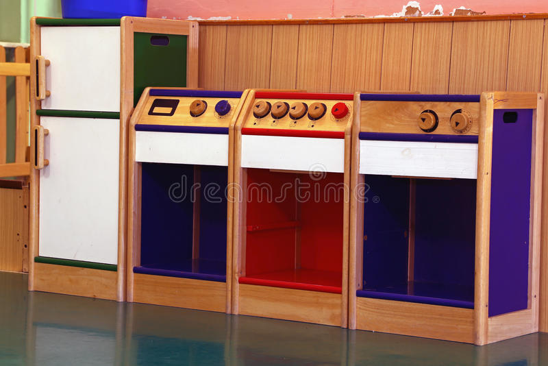 Model of wooden kitchen to play in kindergarten stock Realistic play kitchen