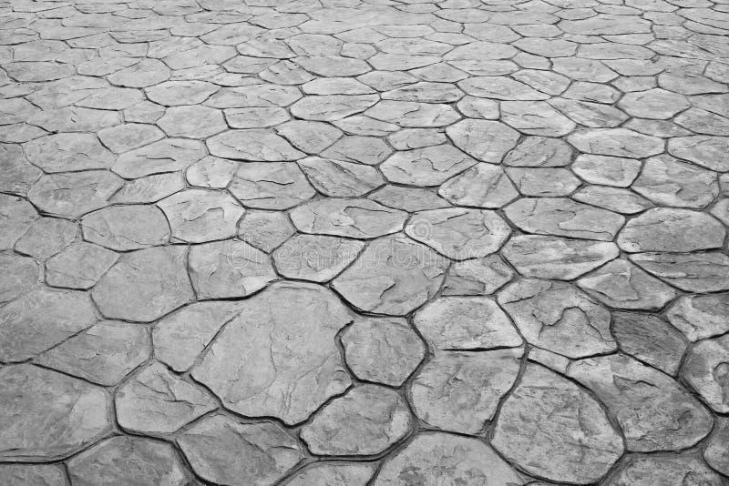 Modela a natureza da maneira de pedra cinzenta ou preta velha sem emenda do trajeto para o fundo ou a textura fotografia de stock