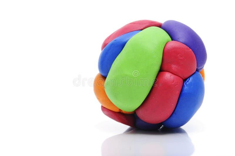 Modelando a esfera da argila imagem de stock