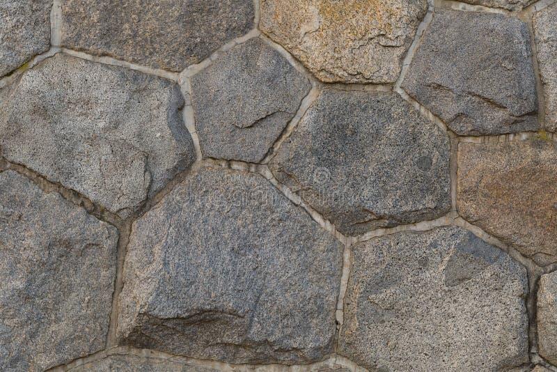 Modele a parede baixa composta da luz segura forte das pedras octogonais sextavadas - cinza imagem de stock
