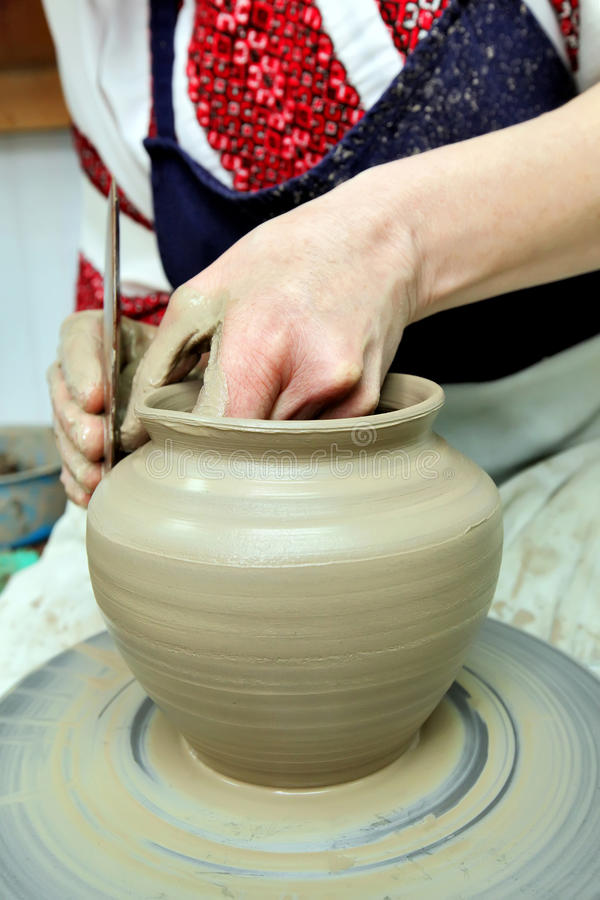 Modeling clay. Handmade pot from clay. The whistle stock photography