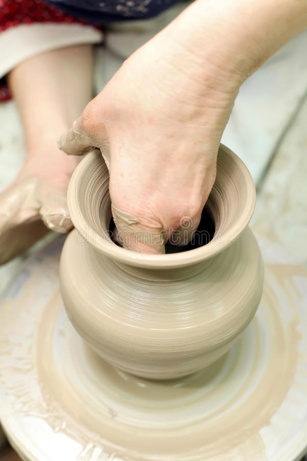 Modeling clay. Handmade pot. Painted glassware stock photo