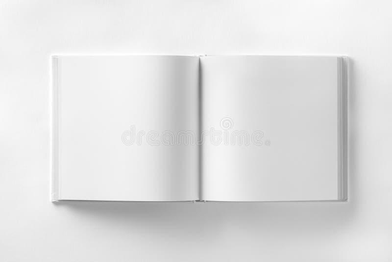Modell av öppnad mellanrumsfyrkantctalogue på vit designpappersbac stock illustrationer