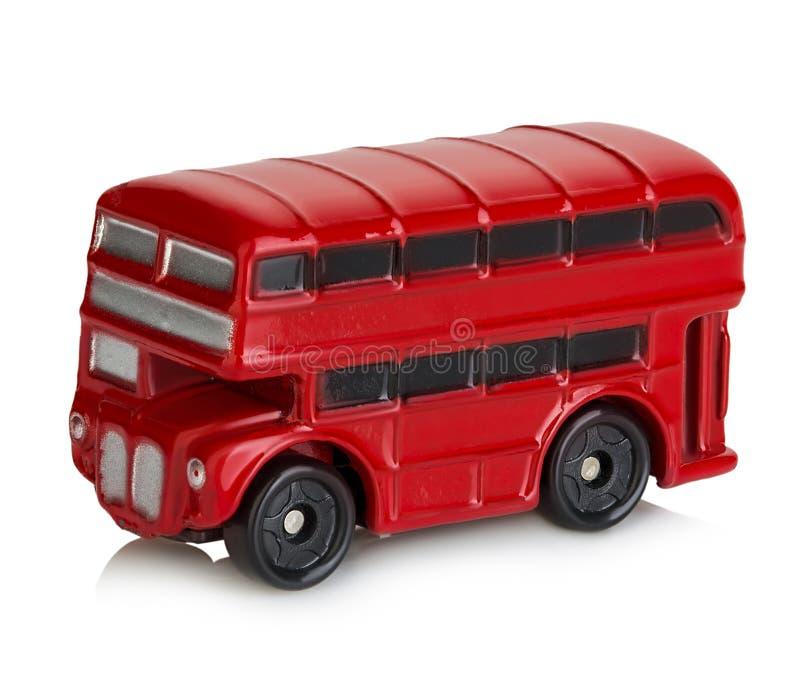 Modell av den klassiska röda London bussnärbilden som isoleras på en vit bakgrund royaltyfri fotografi