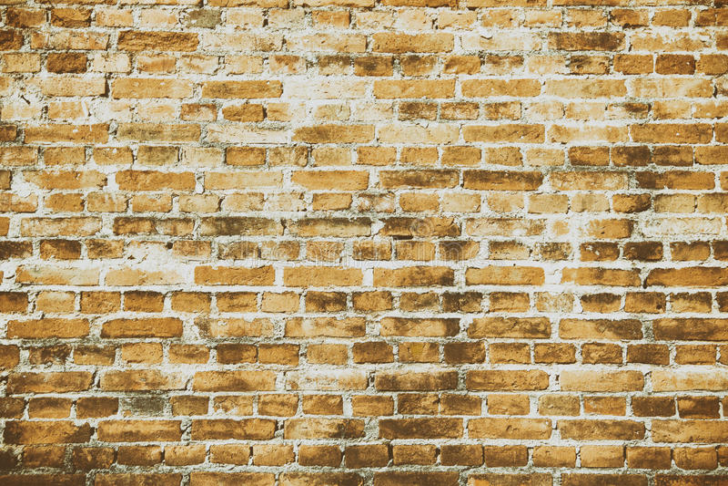 Modell av den orange gamla strukturen för väggtegelstenbakgrund royaltyfri bild