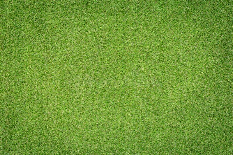 Modell av grön konstgjord grästextur och bakgrund arkivfoton