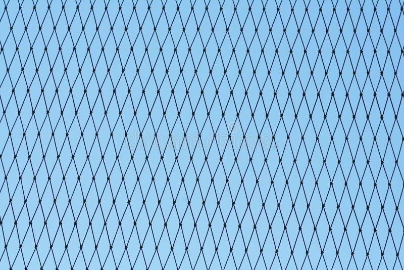 Modell av sömlöst ingreppsnylon på bakgrund för blå himmel royaltyfria foton