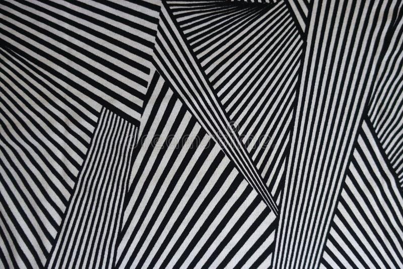 Modell av svartvita linjer på tyg royaltyfri fotografi