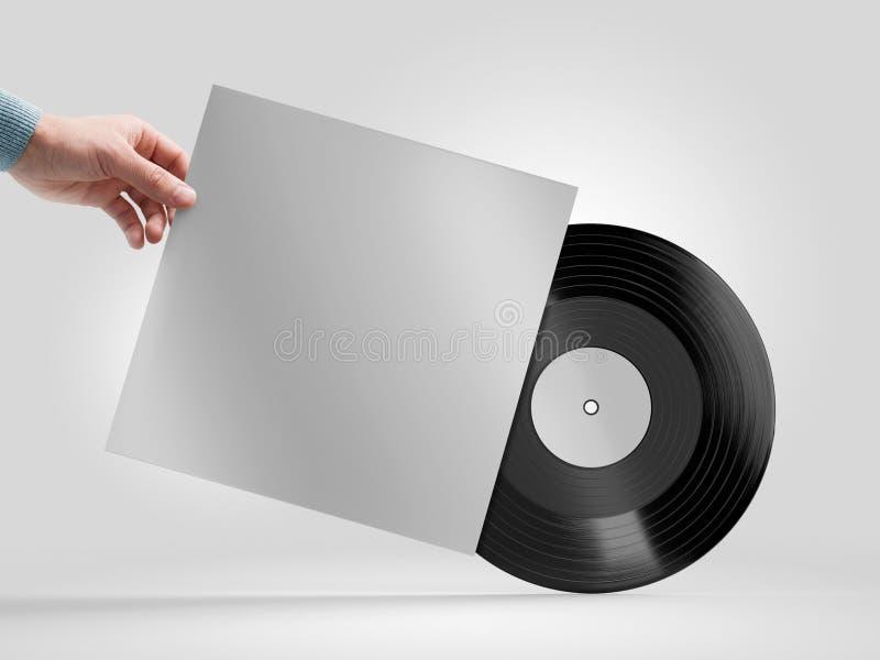 Modell der Vinylaufzeichnung in der Hand lizenzfreie stockbilder