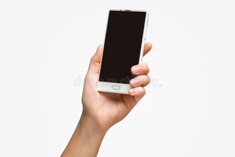 Modell der weiblichen Hand frameless Handy mit schwarzem Schirm halten stockfotografie