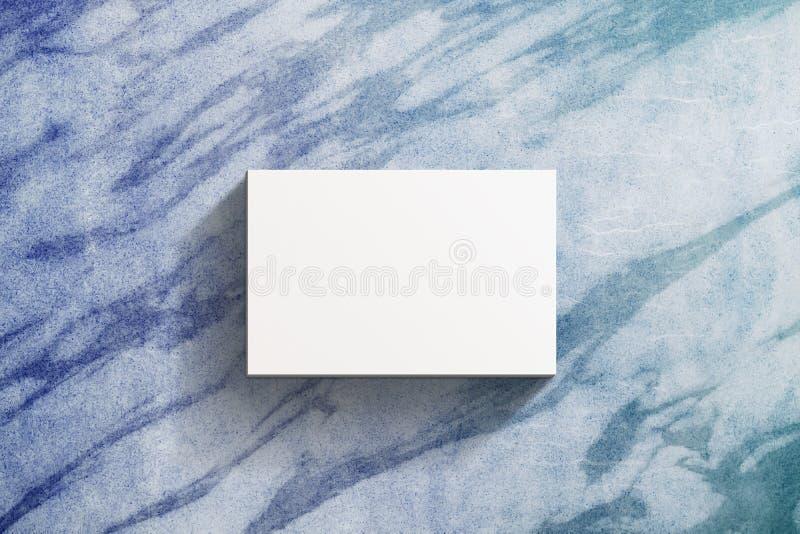Modell för affärskort som är närvarande över marmortabellen, tom vit royaltyfria bilder