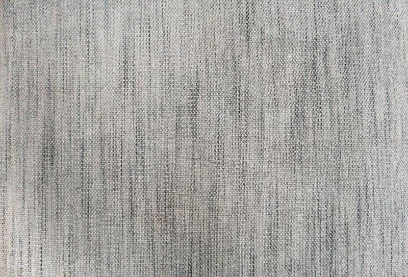 Modell för bakgrund för grått tweedtygfragment sömlös arkivbilder