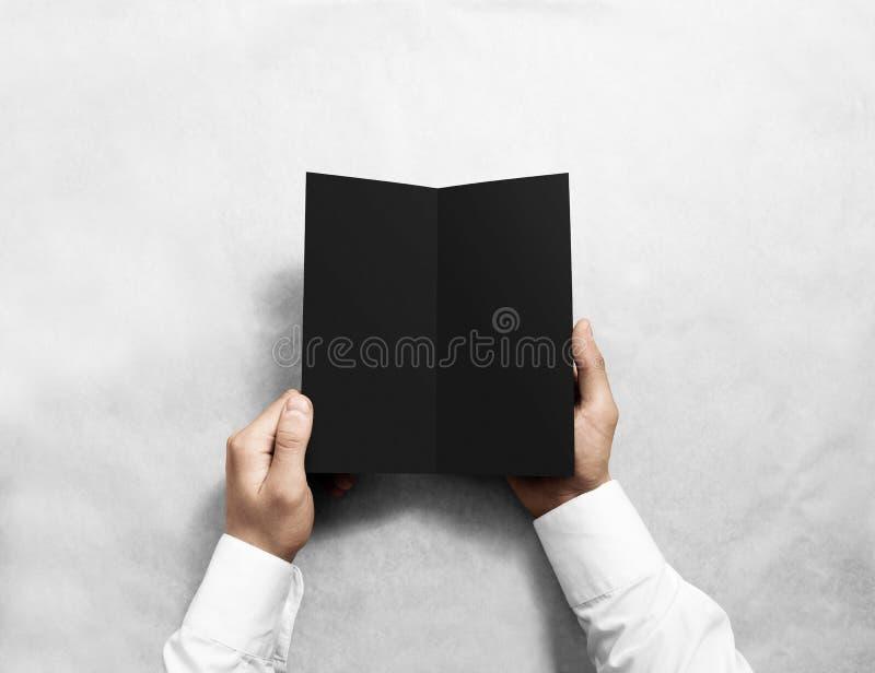 Modell för häfte för broschyr för reklamblad för svart för handöppningsmellanrum Broschyrpresentation royaltyfri fotografi
