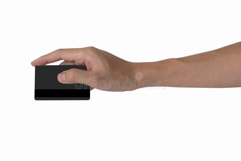Modell för kreditkort för svart för mellanrum för innehav för hand för man` s med svartmag royaltyfria bilder