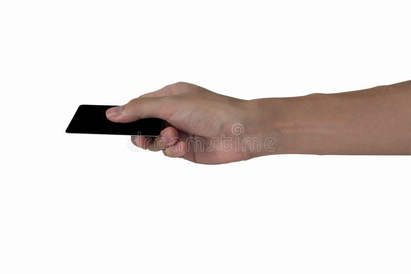 Modell för kreditkort för svart för mellanrum för innehav för hand för man` som s isoleras med arkivbilder