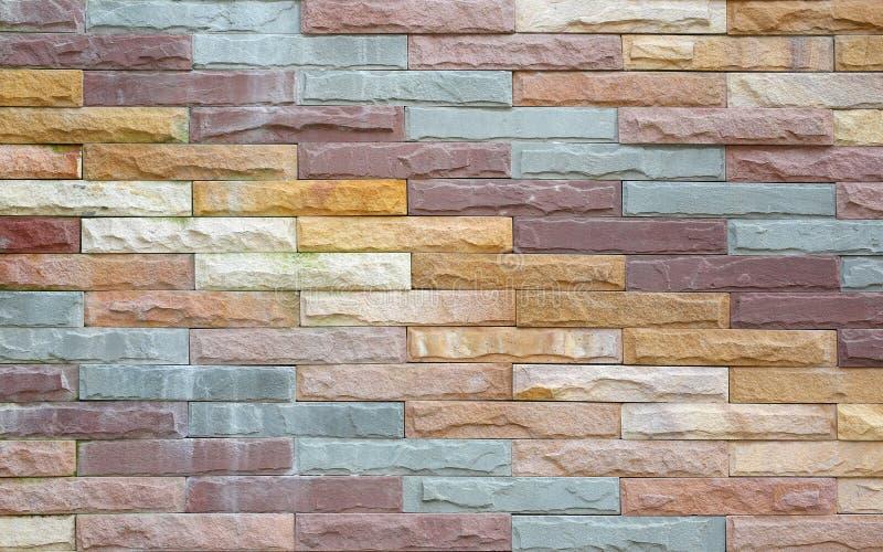 modell för Mång--färg tegelstenvägg, dekorativ modern stil för stenvägg arkivbilder
