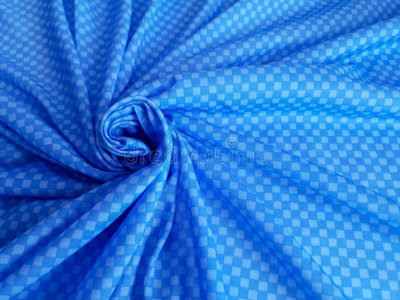 Modell textur, bakgrund, tapet Mjuk blå och vit bomullsprövkopia med den geometriska prydnaden arkivbild