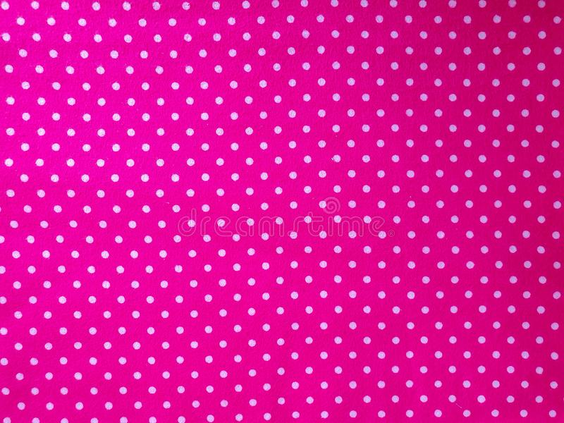 Modell textur, bakgrund, tapet Mjuk ljus rosa bomullsprövkopia med vita prickar, med den geometriska prydnaden Slapp fokus arkivbilder