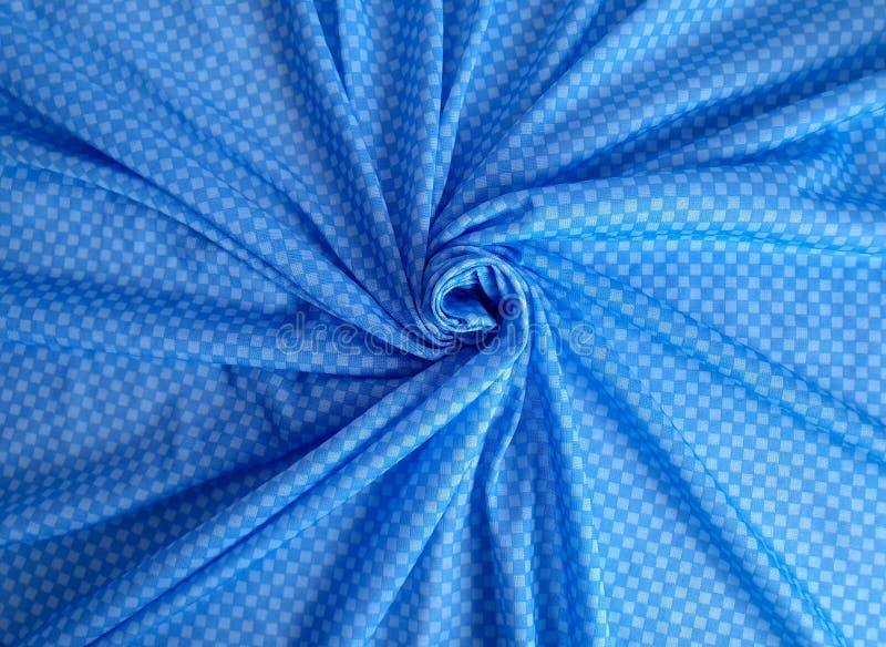 Modell textur, bakgrund, tapet Mjukt blått bomullstyg med minimalistic geometriska prydnadrektanglar av blått ljus - royaltyfria foton