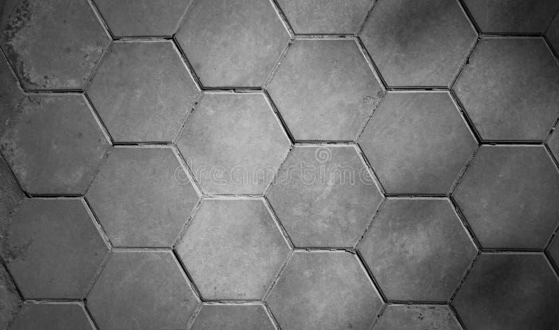 Modellato pavimentando le mattonelle, il nero del fondo del pavimento del mattone del cemento e fotografia stock libera da diritti