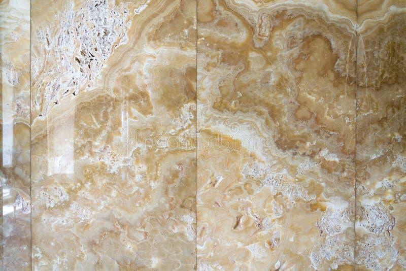 Modeller för textur för härlig onyxsten naturliga, designvägg, modern arkitektur, vitt, gult och brunt royaltyfri foto