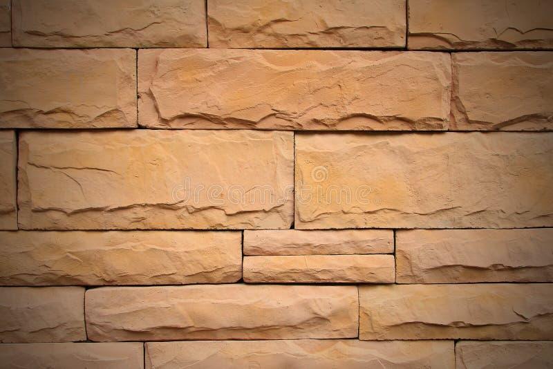 Modelli la struttura della parete di pietra per progettazione e vecchia la parete di mattoni marrone alta interna e vicina fotografie stock