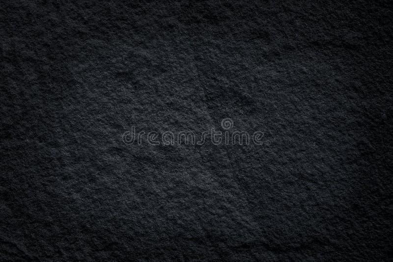 Modelli neri della pietra dell'ardesia o estratto naturale di struttura grigio scuro della pietra su fondo fotografia stock