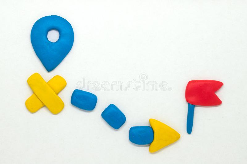 Modelling clay navigation sign on white background. Bright navigation sign isolated. Road signs clipart. Route start and destination pointer. Red flag for royalty free stock images