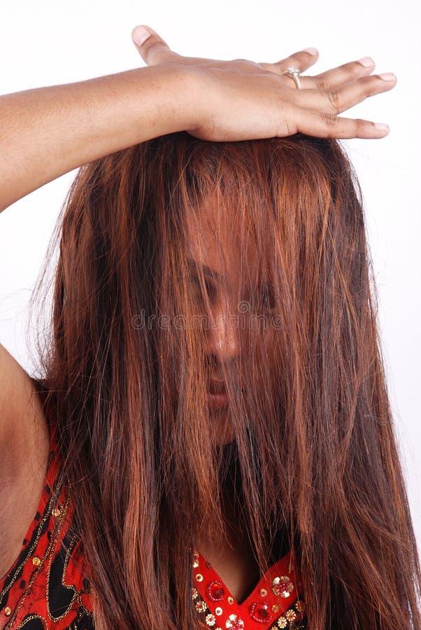 Modello asiatico con capelli in fronte fotografie stock