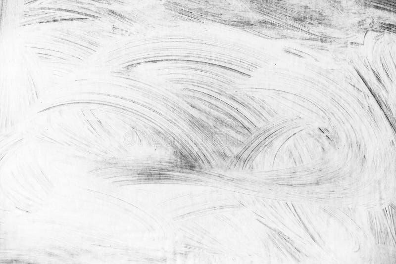 Modello bianco astratto della pittura sopra la parete grigia immagini stock libere da diritti