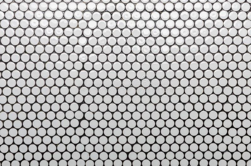 Modello bianco delle mattonelle del cerchio come fondo immagine stock