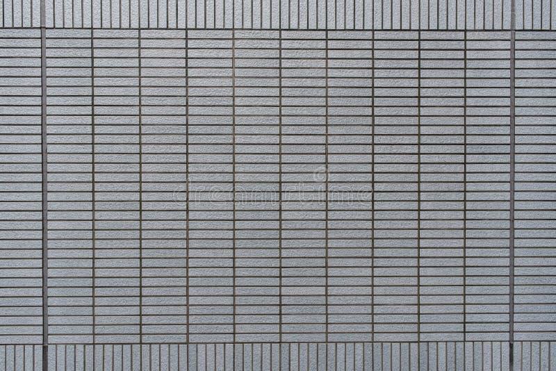 Modello del blocco quadrato della parete di pietra moderna grigia immagini stock libere da diritti
