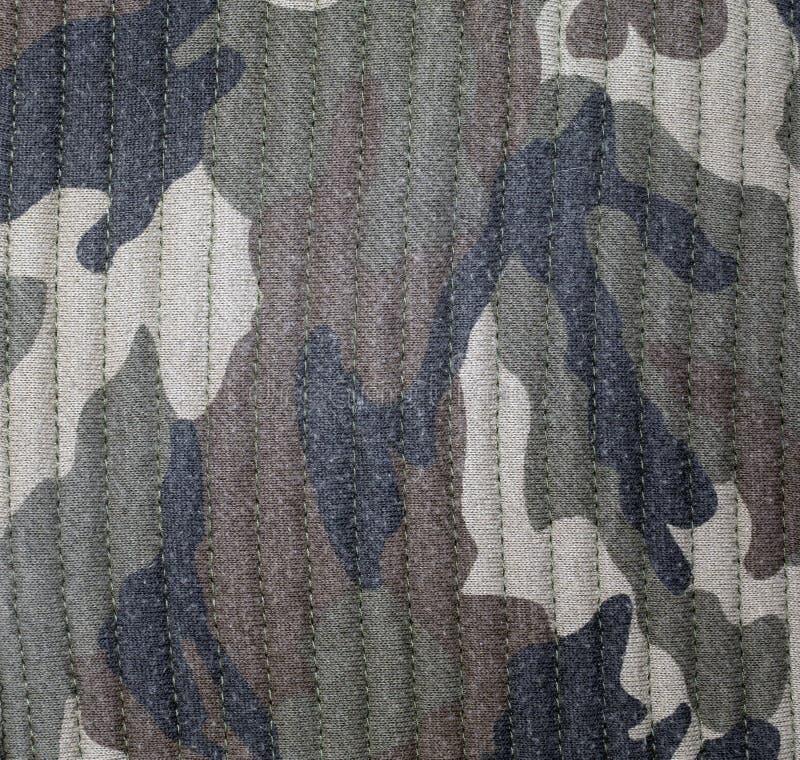 Modello del fondo di colore dell'uniforme del cammuffamento del tessuto Fondo e struttura astratti per progettazione fotografia stock libera da diritti