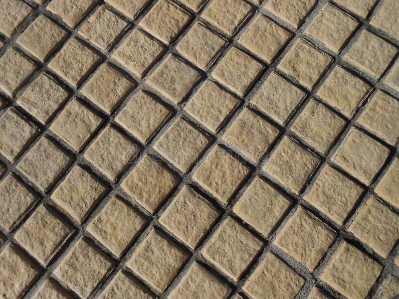 Modello della pietra di Brown nella struttura del fondo fotografia stock