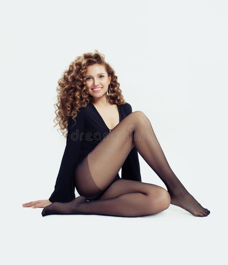 Modello di moda della donna con le belle gambe fotografia stock libera da diritti