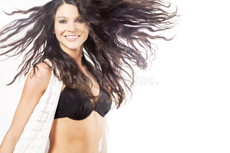 Modello di modo femminile con capelli ricci lunghi. fotografie stock