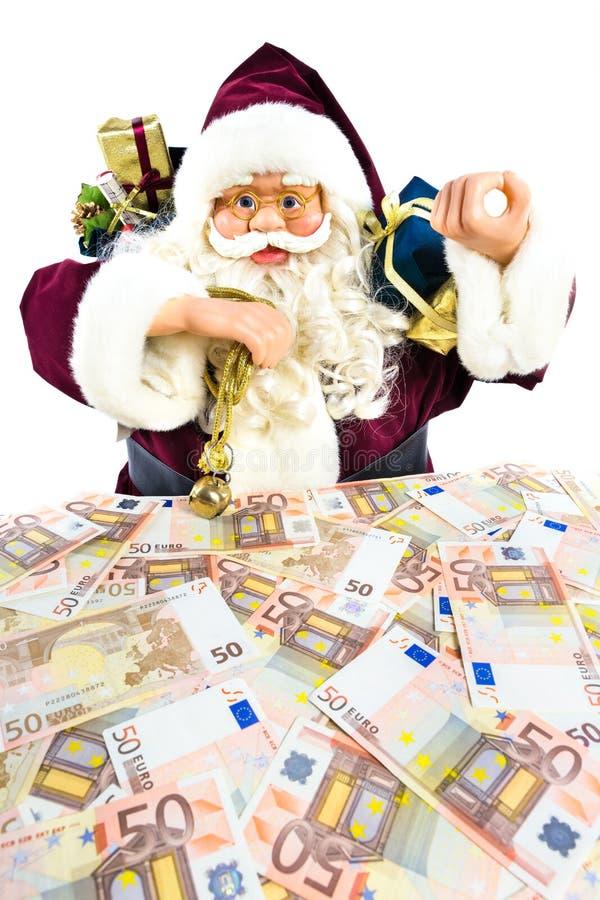 Modello di Santa Claus con i regali e gli euro soldi immagine stock