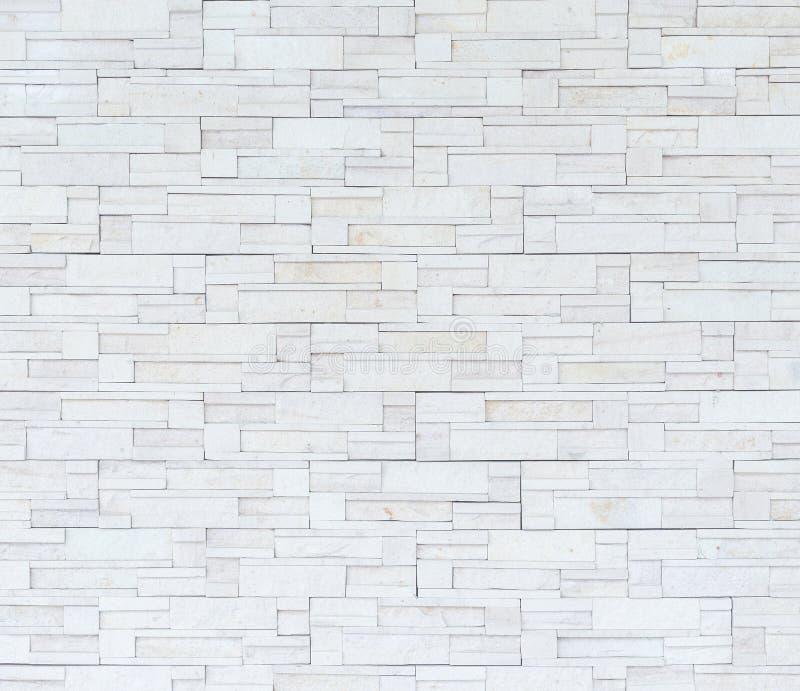 Modello di struttura grigia ed approssimativa della parete dell'arenaria per fondo fotografie stock