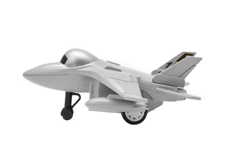 Modello di un giocattolo dell'aereo da caccia isolato su fondo bianco fotografie stock libere da diritti
